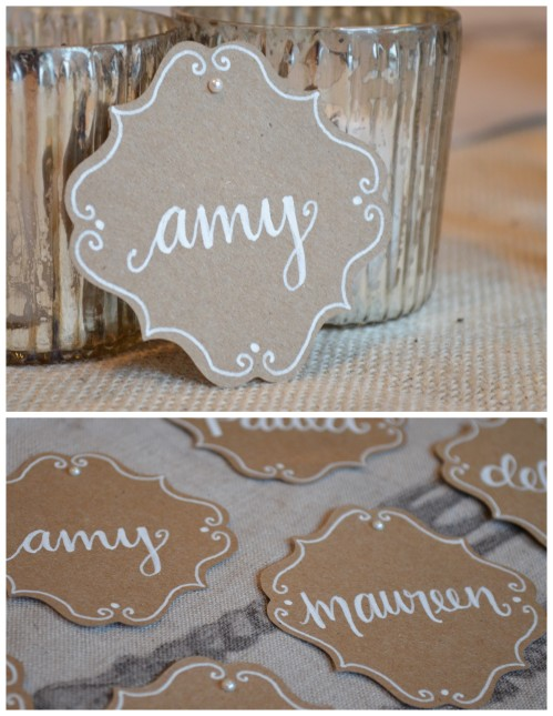 Kraft paper bracket place cards with white lettering and pearl detail
