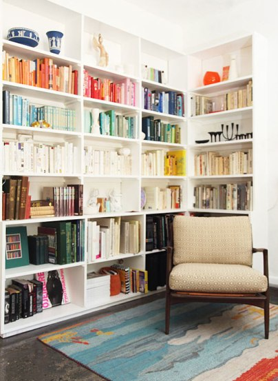 John and Tyke Colorful Bookshelf via Apartment Therapy