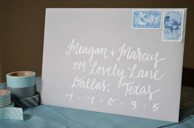 affordable white calligraphy lettering on grey envelope. teal. wedding shower. one charming life.