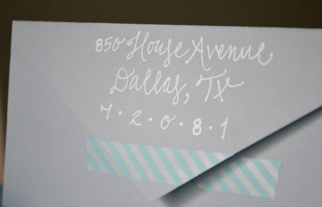 white calligraphy lettering on grey envelope - affordable - with teal washi tape.