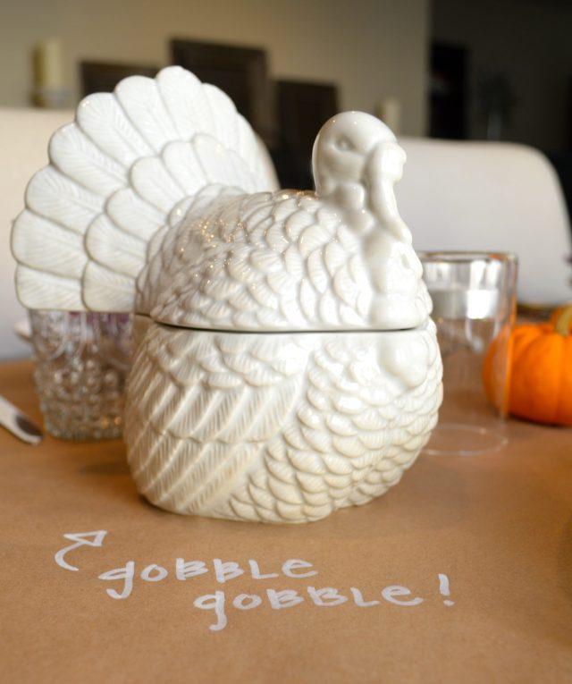 Simple Thanksgiving Table Decor. Kraft Paper and Pens. White Ceramic Turkey.