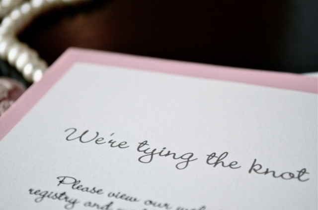 We're tying the knot - black and pink wedding save the dates