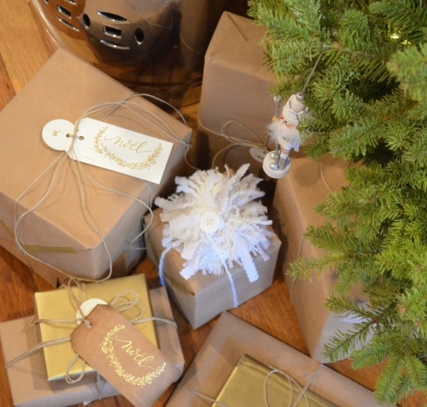 kraft paper, twine and gold wrapped Christmas presents