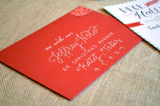 red envelope with white lettering from one charming life